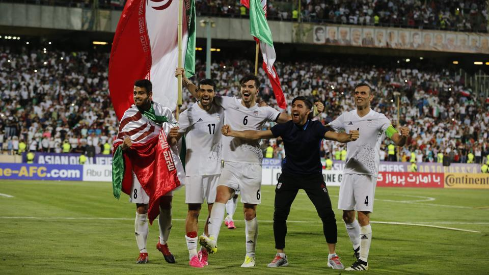 Iran's players celebrate after winning the 2018 World Cup qualifying football match against Uzbekistan at the Azadi Stadium in Tehran on Monday.