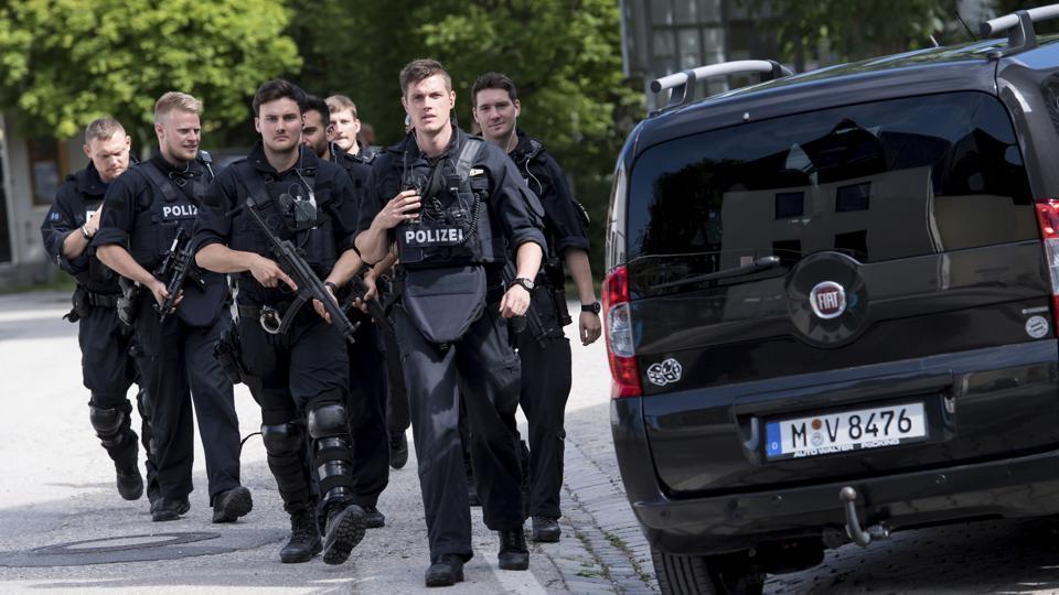 Policemen arrive at Unterfoehring station in Munich on June 13.