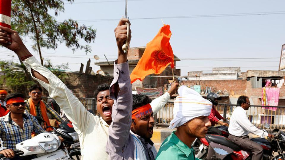 Hindu Yuva Vahini members take part in a rally in Unnao on April 5,  2017.