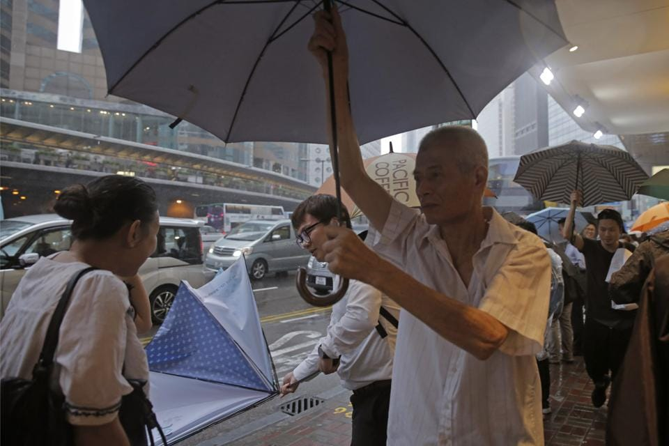 Financial markets, schools, businesses all resumed normal operations on Tuesday, a day after hundreds of thousands of workers scurried home early as authorities hoisted the No. 8 typhoon signal. (Kin Cheung / AP)