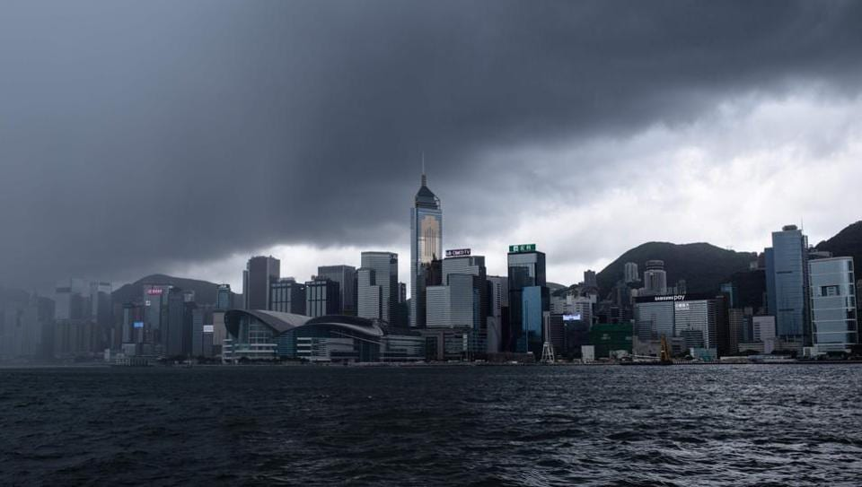 Typhoon Merbok moves away from Hong Kong  without causing any major damage,  as it pounded the financial hub with heavy rain and strong winds before moving further inland on Tuesday towards southern China. (ANTHONY WALLACE / AFP)