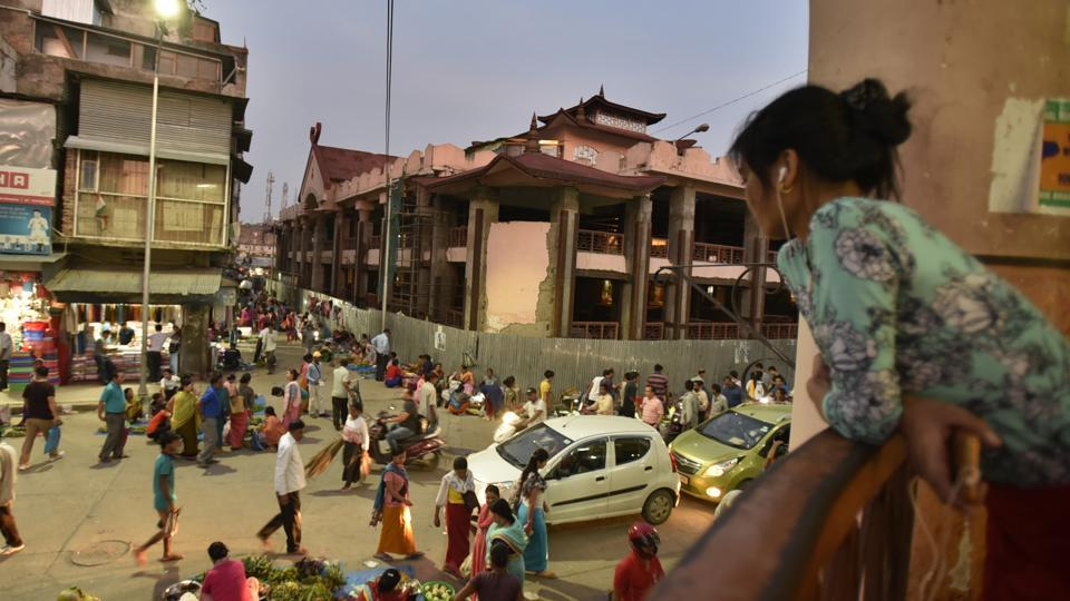 As result of the 2016 Imphal earthquake vendors with space allotted in one of the buildings have now set shop in its perimeter.  (Raj K Raj/HT PHOTO)