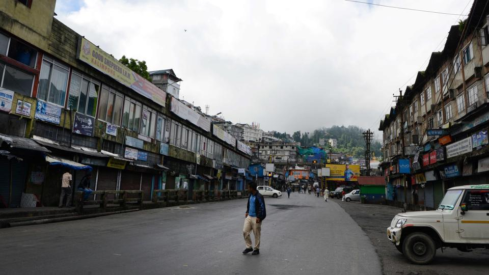 A man walks past closed shops during a general strike called by the Gorkha Janmukti Morcha (GJM) in Darjeeling. Thousands of tourists fled the hill resort after local activists demanding the creation of a new  state warned that a general strike could degenerate into violence.The GJM seemed to gain momentum from a joint forum of 26 trade unions calling for a two-day general strike among tea workers. Currently paramilitary forces are patrolling the city with all government and Gorkhaland Territorial Administration (GTA) offices closed indefinitely. (AFP)