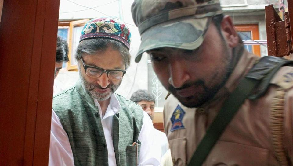Jammu and Kashmir police detain JKLF chairman Mohammad Yasin Malik while he was going for a joint separatist meeting in Srinagar on June 12, 2017.