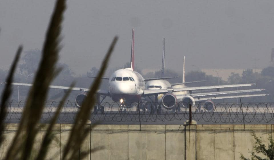 Planes prepare to takeoff from the IGI Airport in Delhi.
