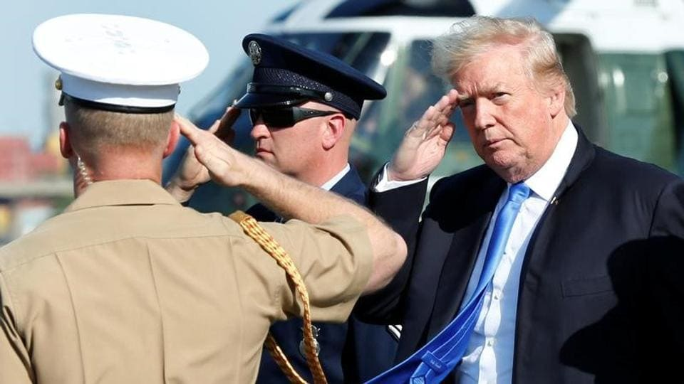 US President Donald Trump salutes as he arrives at Newark International airport in New Jersey on June 9, 2017.