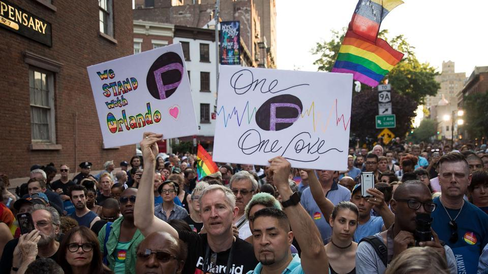 People attend a memorial service and rally for the victims of the 2016 Pulse nightclub shooting, down the street from the historic Stonewall Inn on June 12.