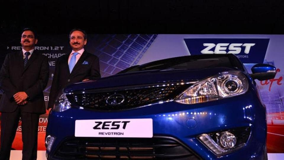 This August 20, 2014 photo shows Ranjit Yadav (R), then president of the PV business unit of Tata Motors with Girish Wagh, then senior VP of Tata Motors' programme planning and project management for passenger vehicles, during the launch of the new Tata Zest in New Delhi.