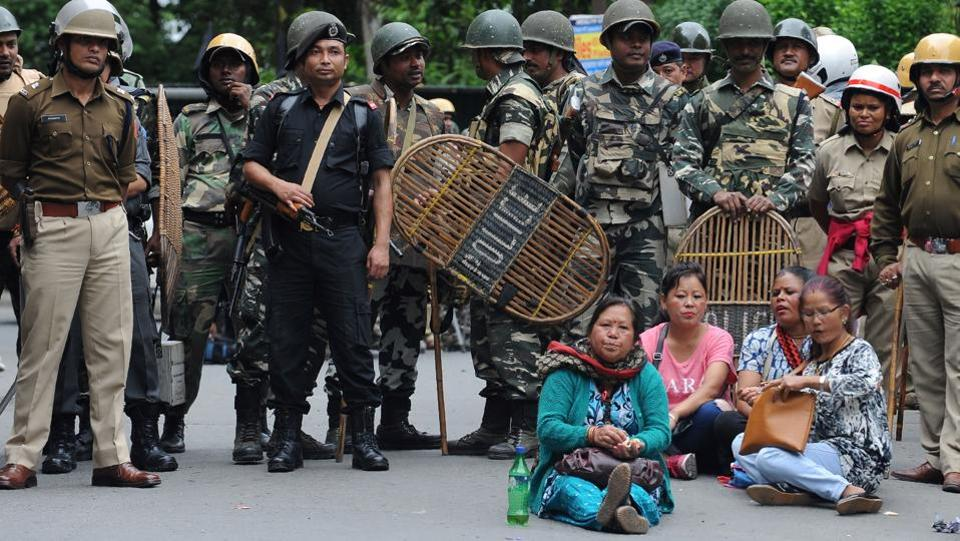 Security personnel stand guard during a protest by supporters of the Gorkha Janmukti Morcha amid a general strike in Darjeeling.  (AFP)