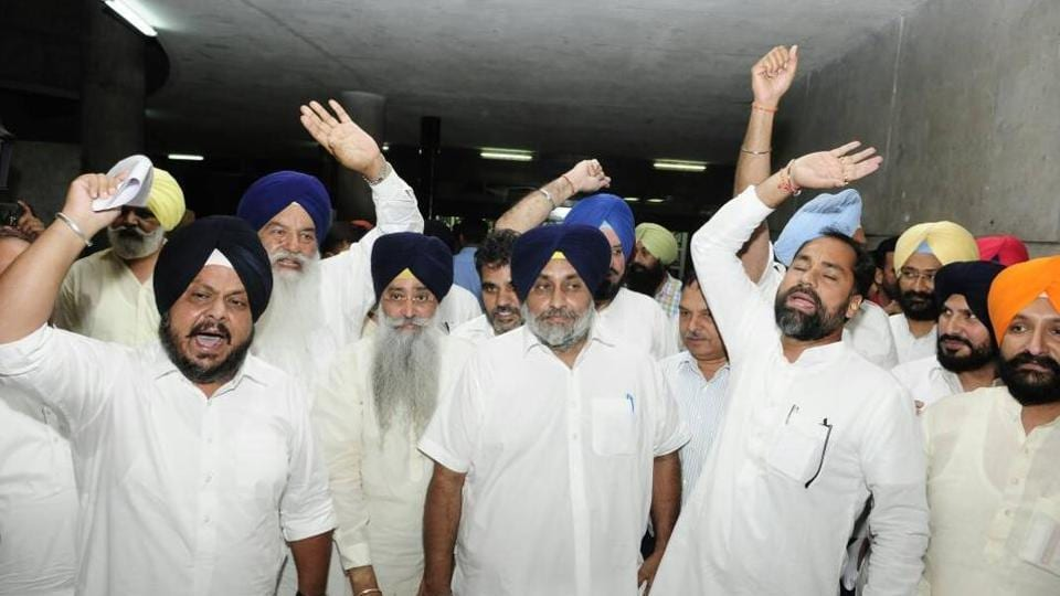 Shiromani Akali Dal president Sukhbir Singh Badal (centre) and other party MLAs walk out of the Punjab assembly to protest obituary reference to former DGP KPS Gill.