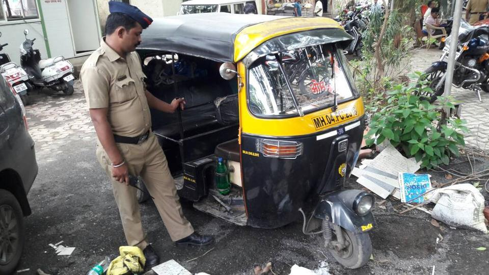 Police with the seized auto on Wednesday.