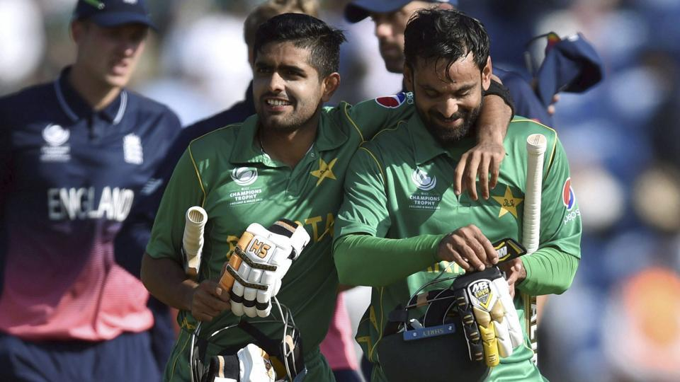 Pakistan's Babar Azam and Mohammad Hafeez celebrate victory as they leave the pitch after winning the ICC Champions Trophy semifinal vs England in Cardiff on Wednesday. Watch match video highlights of England vs Pakistan here.