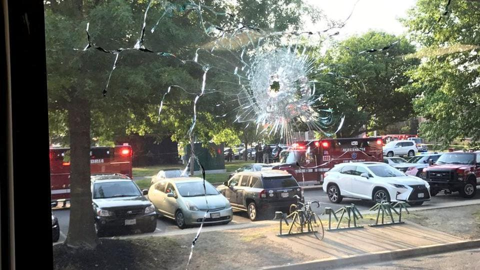 A bullet hole is seen in a window after a gunman opened fire on Republican members of Congress during a baseball practice. The group were practicing for the annual Democrats versus Republicans congressional baseball game that was scheduled to be played on Thursday. (REUTERS)