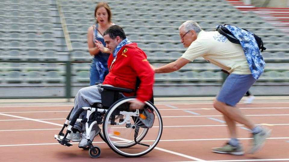 A participant is pushed by an assistant as they take part in the 4x25 metres relay during the 'Olympics for Seniors' event at King Baudouin stadium. (Francois Lenoir / REUTERS)