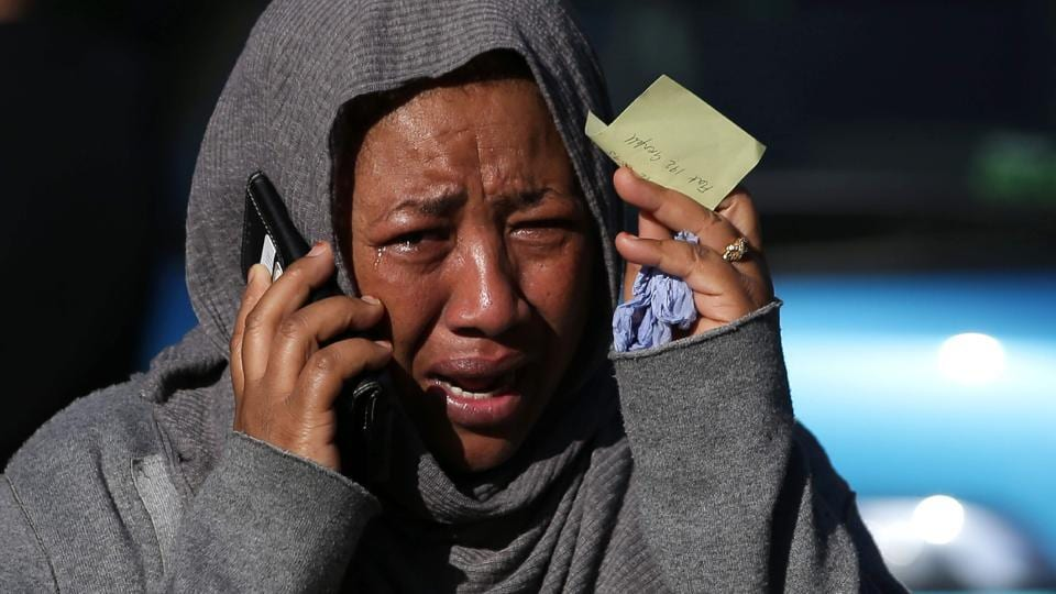 A woman cries as she tries to locate a missing relative suspected of being affected by the massive fire that engulfed Grenfell Tower, a residential block . (Daniel LEAL-OLIVAS / AFP)