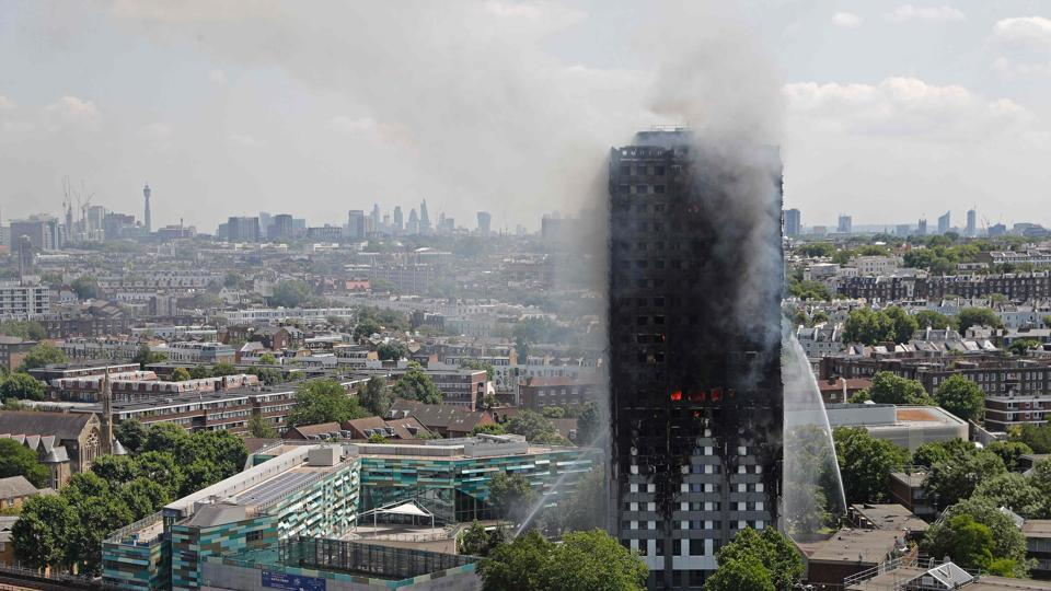 Smoke and flames billows from Grenfell Tower as firefighters attempt to control a blaze at a residential block of flats.