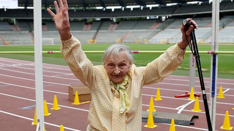 A participant reacts after crossing the finishing line of the steeple chase event during the 'Olympics for Seniors' at King Baudouin stadium in Brussels, Belgium. (Francois Lenoir  / REUTERS)