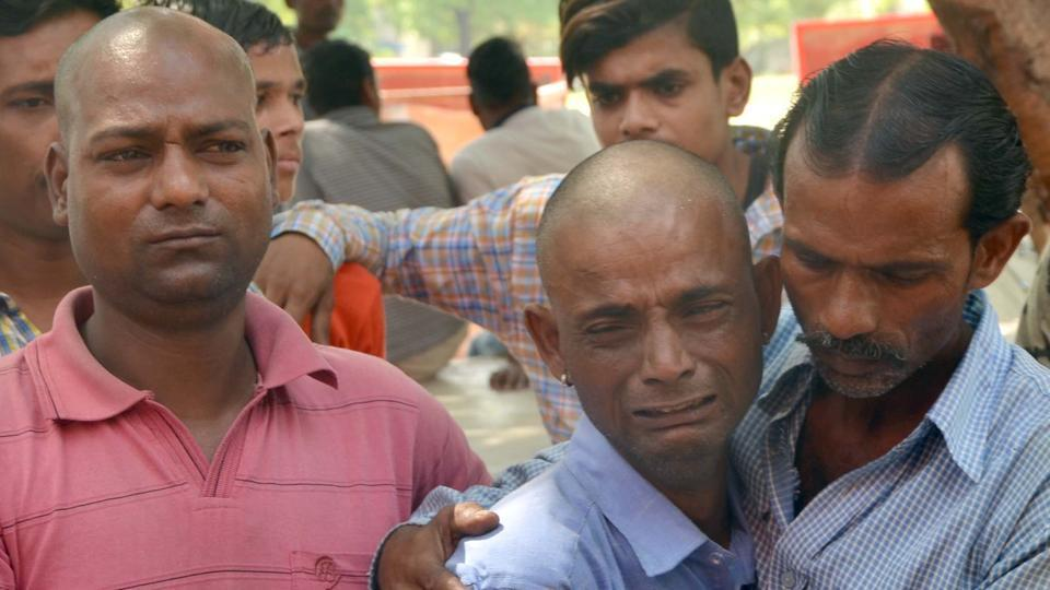 The elder brother, Dhruv Pal, of the deceased Udayveer being consoled by family members at Police station in Sector 31, Chandigarh, on Wednesday.