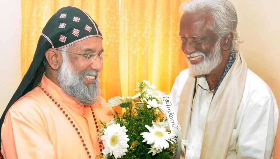 A friendly meeting between a leader of the Kerala unit of the BJP and a local bishop. The state's new Christian Helpline is being set up by a member of the BJP, which is trying to win the support of local Christians.