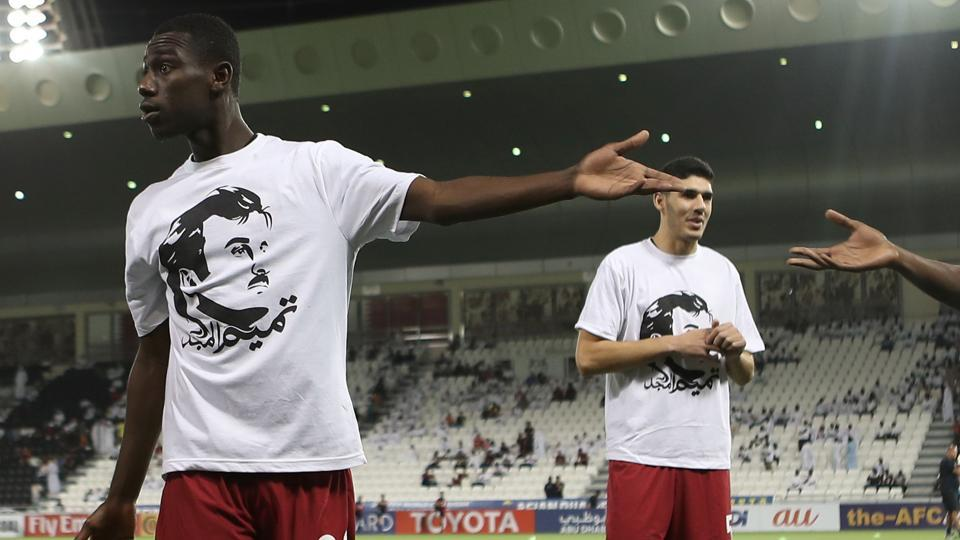 Qatar's national football team displayed white shirts emblazoned with a profile portrait of Emir Sheikh Tamim bin Hamad Al-Thani a a show of defiance in response to the current diplomatic crisis in the Gulf