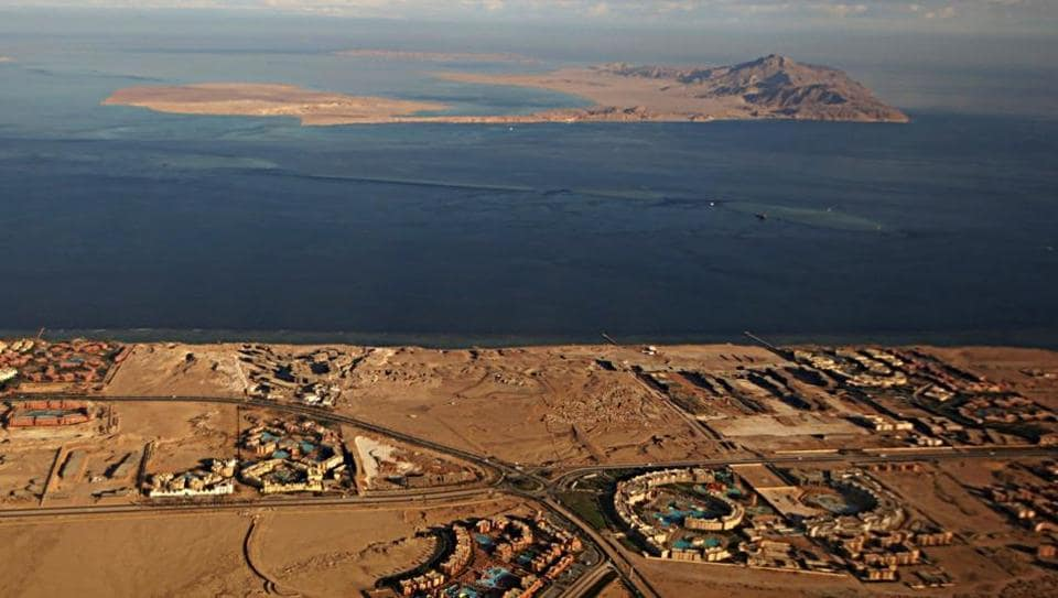 (FILES) This file photo taken on January 14, 2014, through the window of an airplane shows the Red Sea's Tiran (foreground) and the Sanafir (background) islands in the Strait of Tiran between Egypt's Sinai Peninsula and Saudi Arabia. Egypt's parliament agreed on June 14, 2017, a controversial maritime agreement with Saudi Arabia that transfers the two Red Sea islands to the kingdom.