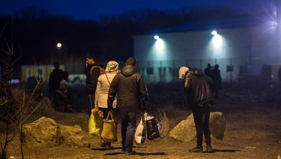 Migrants gathering for a food distribution in Calais.