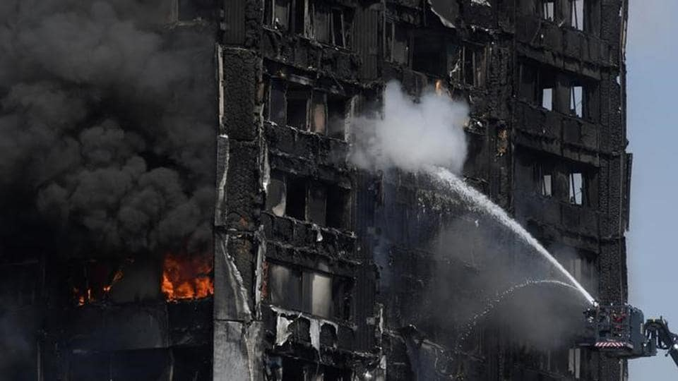 Firefighters direct jets of water onto a tower block severely damaged by a serious fire, in north Kensington, West London, Britain June 14, 2017. A fire ripped through a 24-storey block of flats in west London early on Wednesday, killing at least 17 people and trapping dozens of residents, some of whom were seen throwing children from windows in the hope they survive the blaze. (Toby Melville / Reuters)