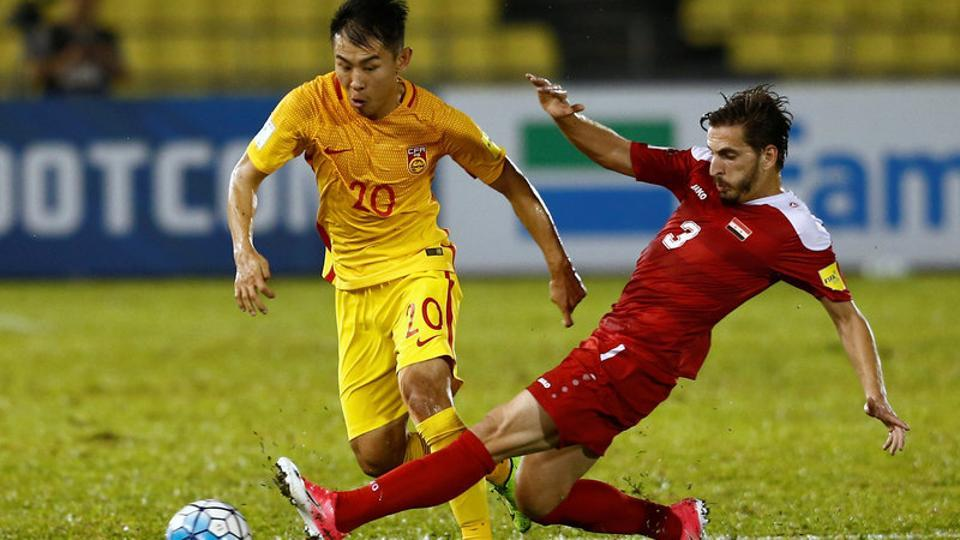 China's Yu Hanchao in action against Syria's Mouaiad Al Ajjan during a 2018 World Cup qualifier.