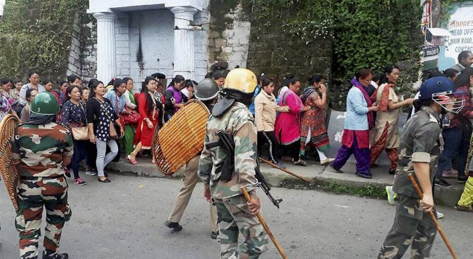 Security personnel take position a protest by Gorkha Janmukti Morcha in Darjeeling Hills on Tuesday.