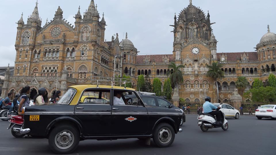 The compact black-and-yellow cabs, designed on an Italian Fiat with elaborately patterned interiors were once ubiquitous across the congested roads of India's financial capital and had featured in countless Bollywood movies.  (INDRANIL MUKHERJEE  / AFP)