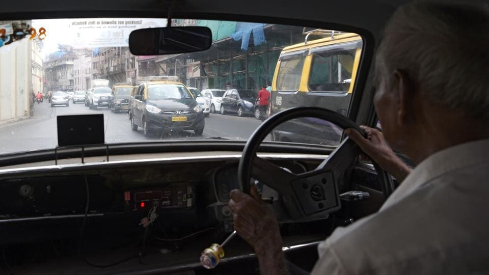 Indian taxi driver Dawood Khan, 80, drives his Premiere Padmini taxi in Mumbai. For many the passing of the Indian-built vehicle will be the end of an unforgettable chapter in Mumbai's history. (INDRANIL MUKHERJEE  / AFP)
