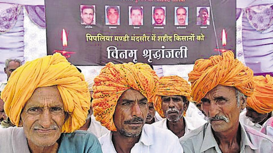 Farmers take part in a condolence meet organised for the victims of Mandsaur police firing at Unhel village in Ujjain on June 13.