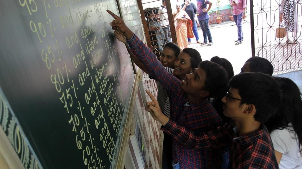 Students check their results in Thane.