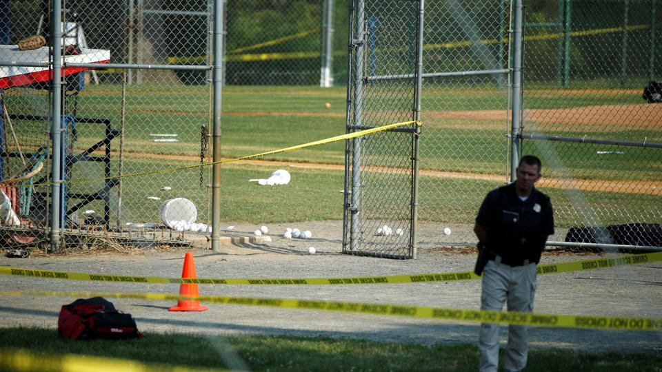 A police officer mans a shooting scene near Washington in Alexandria, Virginia. As per witnesses, 50-100 shots were fired from a chain link fence.  (REUTERS)