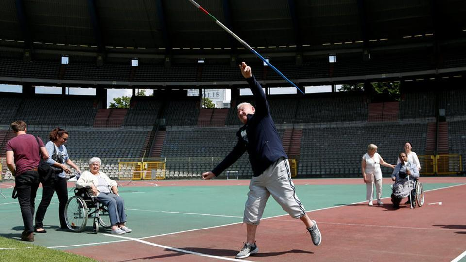 A participant takes part in the javelin throw event. (Francois Lenoir / REUTERS)