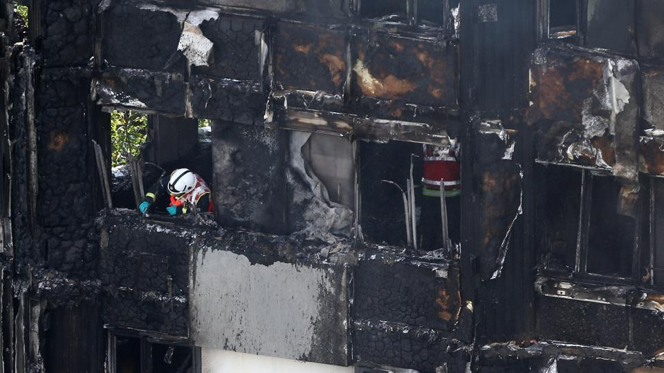 Eyewitnesses said they had also seen some people fall or jump from the Grenfell Tower, a 1970s building in the working-class north Kensington area, after it caught fire at around 1am UK time (0530 India time).  (Neil Hall / REUTERS)