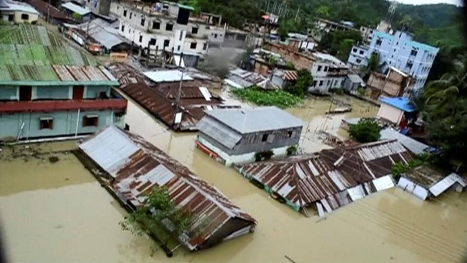An aerial view shows the town of Khagrachari half-submerged in floodwaters following heavy rain on Tuesday, June 13.