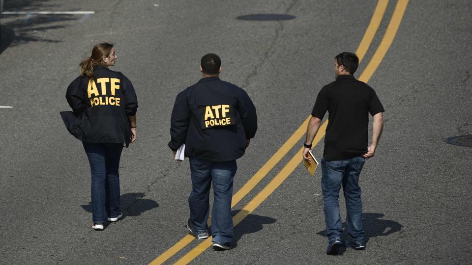 Bureau of Alcohol, Tobacco, Firearms and Explosive (ATF) police members walk near the crime scene. (Brendan Smialowski/AFP)