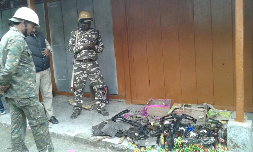 Police personnel with bows, arrows and explosives seized from GJM office in Darjeeling on Thursday.