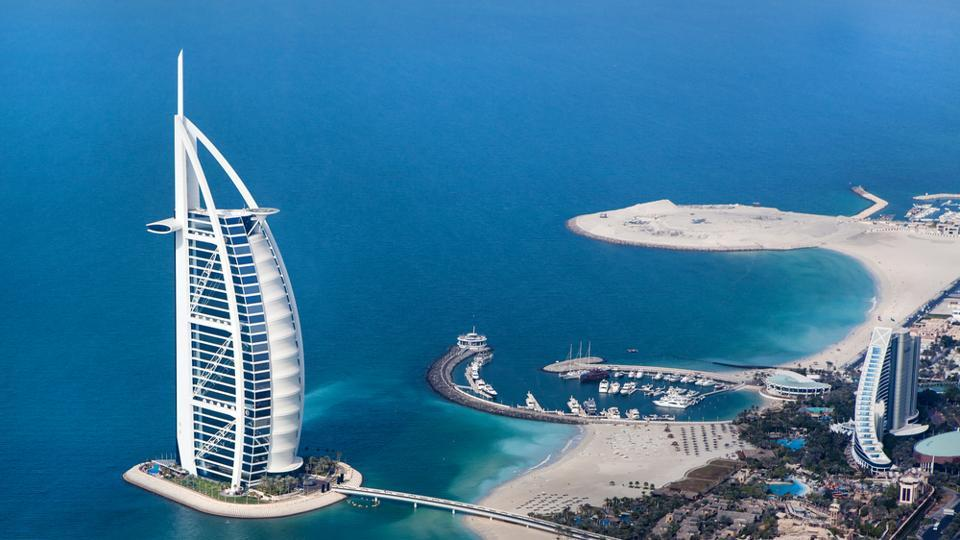 Burj Al Arab Hotel. It  is a luxury 5 star hotel built on an artificial island in front of Jumeirah Beach.