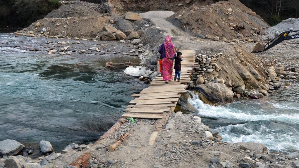 Numerous makeshift footbridges like the one above are yet to be replaced in the interior areas of the Kedarnath valley.
