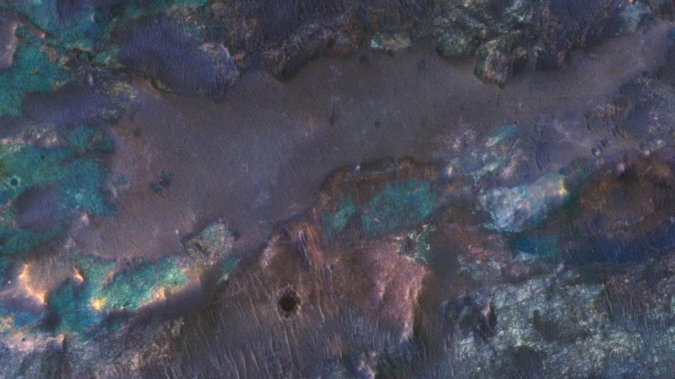 Colourful Impact Ejecta from Hargraves Crater:  The collision that created Hargraves Crater impacted into diverse bedrock lithologies of ancient Mars.