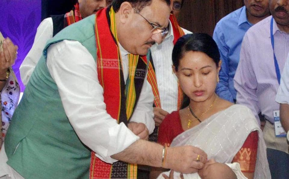 Union health minister JPNadda administering a dose of rota virus vaccine to a child in Agartala earlier this yea