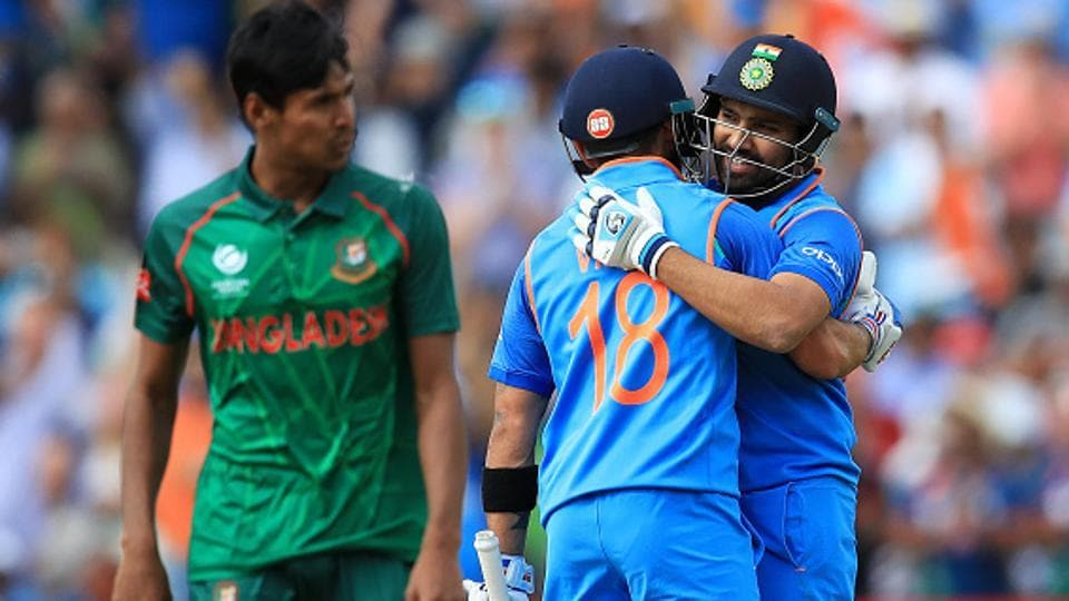 India cricket team skipper Virat Kohli congratulates Rohit Sharma after the opener reached his century during their ICC Champions Trophy semifinal against Bangladesh cricket team at Edgbaston, Birmingham, on Thursday.