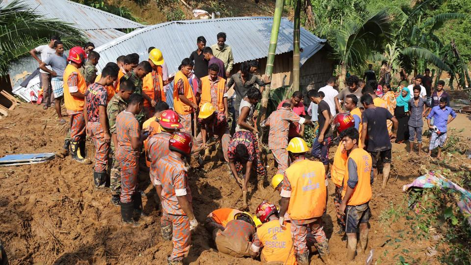 Bangladeshi firefighters search for bodies after a landslide in Rangamati on June 14, 2017. Rescue workers battled June 14 to reach victims of the worst landslides ever to hit Bangladesh, as the death toll rose to 146, with dozens more still missing.