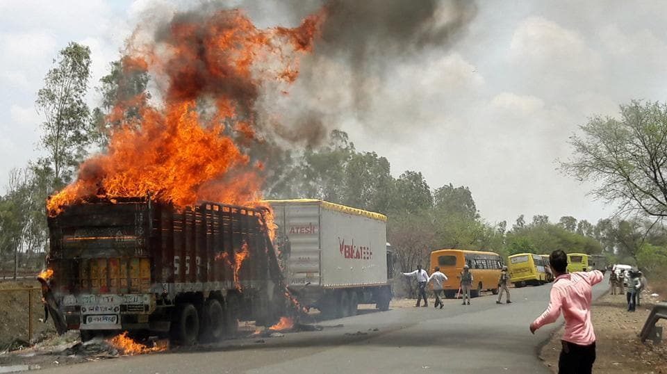 A truck burns during a farmers protest on a highway near Bhopal in Madhya Pradesh, June 9