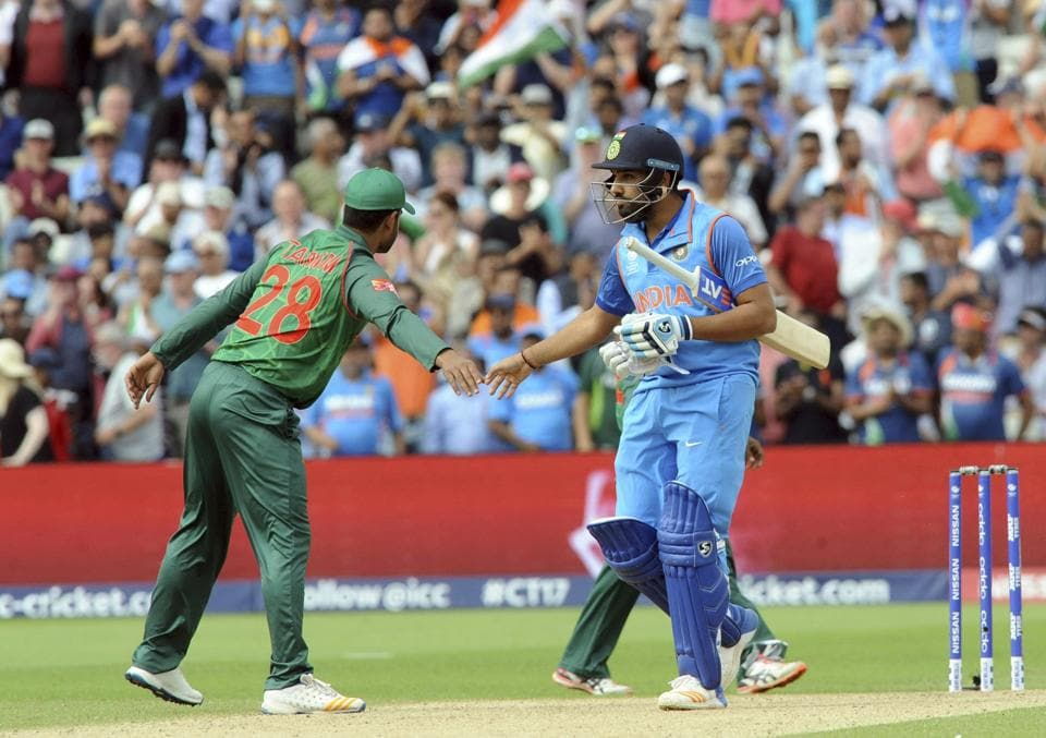 India's Rohit Sharma, right, is congratulated by Bangladesh's Tamim Iqbal after their victory. (AP)