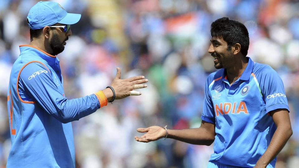 India's Yuvraj Singh, left, and  Jasprit Bumrah react during the ICC Champions Trophy semifinal match. (AP)
