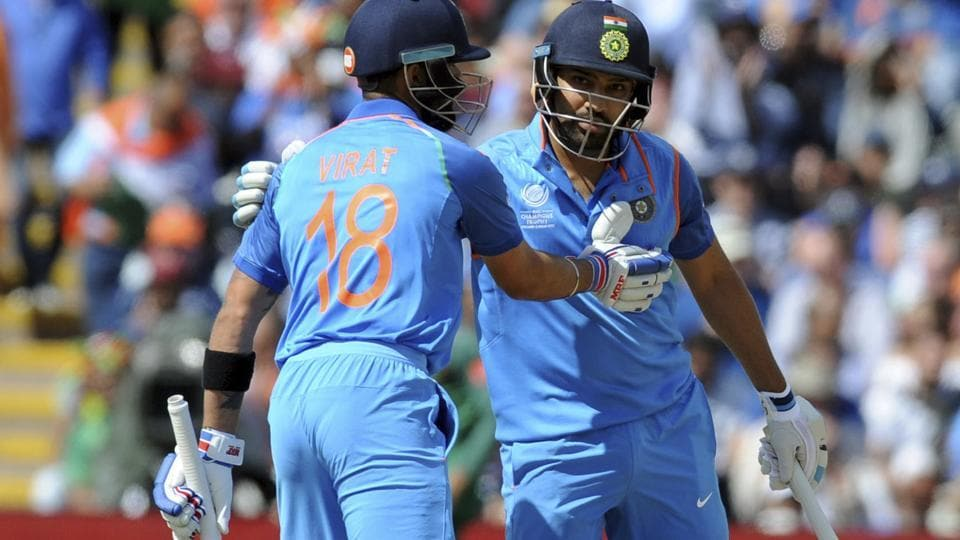 India captain Virat Kohli, left, congratulates India's Rohit Sharma after he reached a century during the ICC Champions Trophy match against Bangladesh.