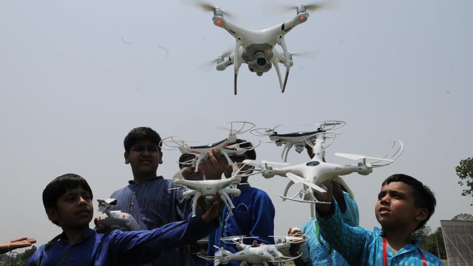 Excited children flying drone in a drone flying contest at the La Martiniere College  ground in Lucknow on Thursday.